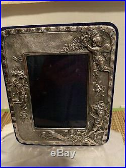 English Vintage High relief Cherub picture frame Sterling Silver. Holds 5x31/2