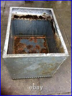 Galvanised riveted vintage water tank could be used as planter or water feature