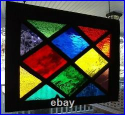 Stained glass in vintage diamond window