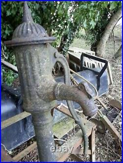 Vintage cast iron water hand pump