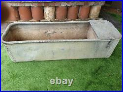 Vintage rivited galvanized water trough rounded top make lovely garden planter