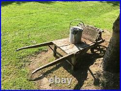 Vintage wooden wheelbarrow